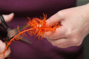 Geschenk-rot-orange-Fusselband